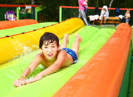 kids have fun in summer open air outdoors amusement water park