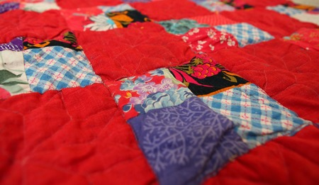 patchwork quilt in the village interior close up