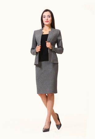 streight: brunette business executive woman with streight hair style in jacket skirt power suit full body photo high-heeled shoes isolated on white Stock Photo