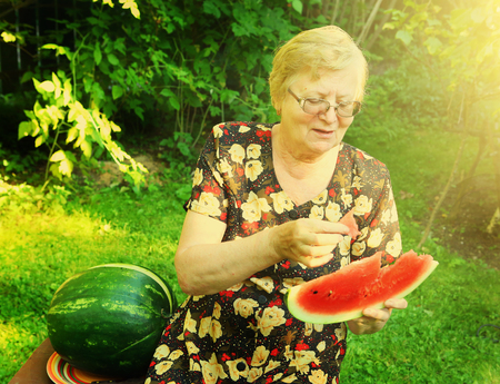near sighted: pensioner old woman with water melon slice