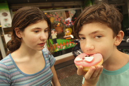 brother and sister with doughnut