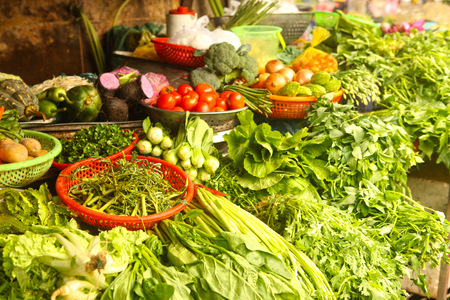 salat: fresh vegetables salat onion green on market