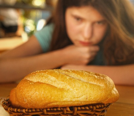 teen girl with bread loaf seduction dieting loosing weight