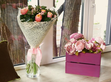 restaurant peony flowers window decoration in wooden box close up photo