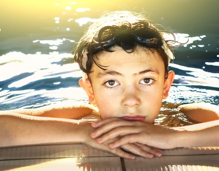 teen preteen boy in swiming pool close up face portrait Stock Photo