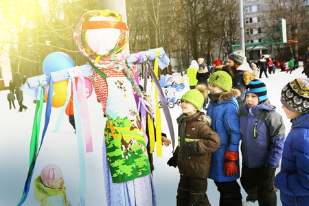Moscow, Russia Februar 16, 2017: Unidentifyed school kids celebrate Maslenitsa Pancake week - purely Russian Holiday that dates back to the pagan times. People eat pancakes, play folk games, have fun letting long annoying winter out, Moscow, Februar 16, 2