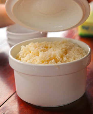 rice and beans: boiled rice in china pan bowl with cover lid close up photo