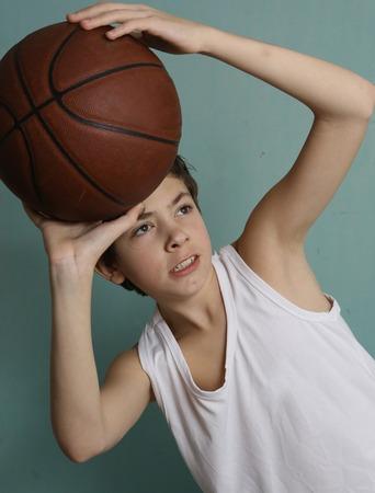teenager boy with basketball ball Stock Photo