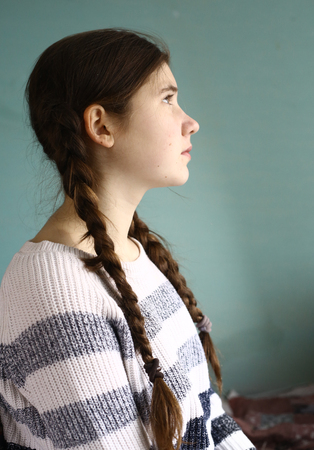 teenager girl with long plaits half face close up portrait Stock Photo