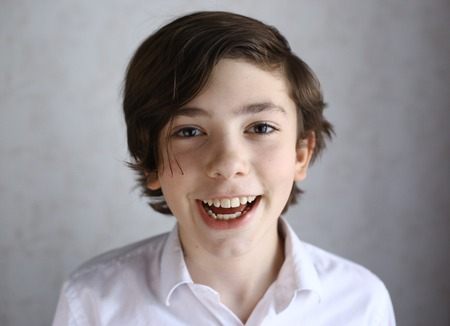 preteen boy laughing smiling portrait close up photo