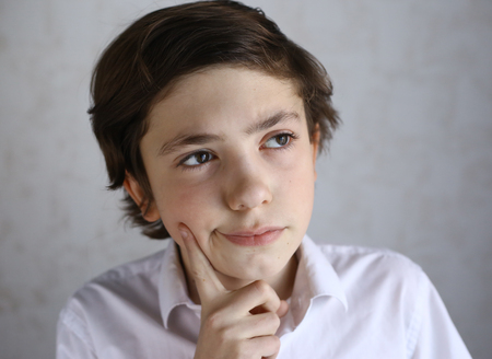 preteen kid boy think the idea over Stock Photo