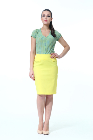 indian woman in summer yellow skirt and green tshirt full body length high heeled shoes back shot isolated on white