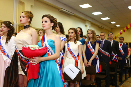 Moscow, Russia - June 24, 2016: Unidentified school pupils in formal dress and suit greeting their teachers in solemn graduation party festive day.