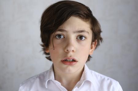niños actuando: preteen boy with fear afraid expression close up portrait