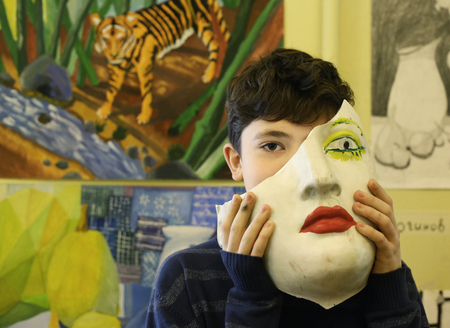 Moscow, May 23 2017: Art school student boy with his painting on final annual exhibition show  in Moscow, Russia, May 23 2017.