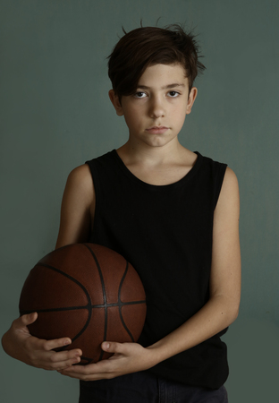 teenager boy with basketball ball close up portrai