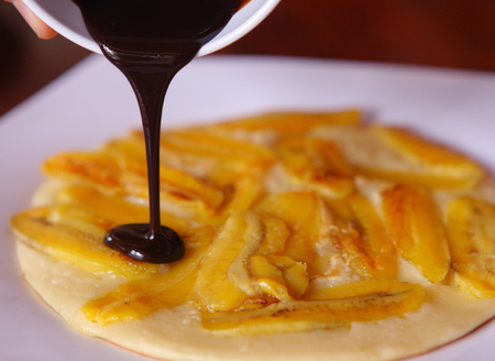 angled: banana pancake with chocolate sauce close up photo Stock Photo