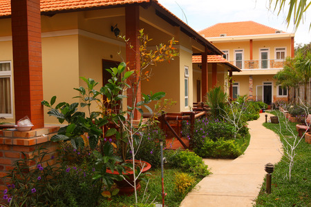 asian bungalow hotel close up photo with flower bed Stock Photo