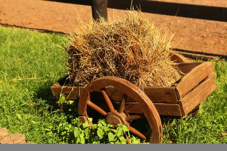 decorative horse cart with hay as a landscape design idea Stock Photo