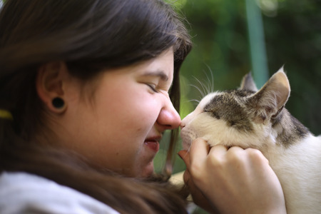 teenager girl kissed tom mail cat close up summer outdoor photo