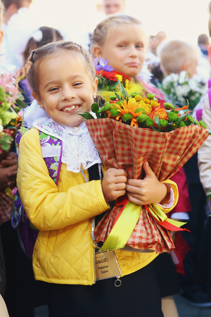 first year student: Moscow, Russia,September 1,2016: Unidentified first grade school kids with flowers bouquet celebrate their first school day before going to classes in Moscow, September 1, 2016.