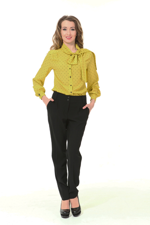 blond business woman in yellow official formal blouse black trousers high heeled shoes full body portrait isolated on white Stockfoto