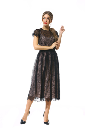 clerk manager business woman in formal black lace party dress stiletto heels shoes isolated on white full body portrait