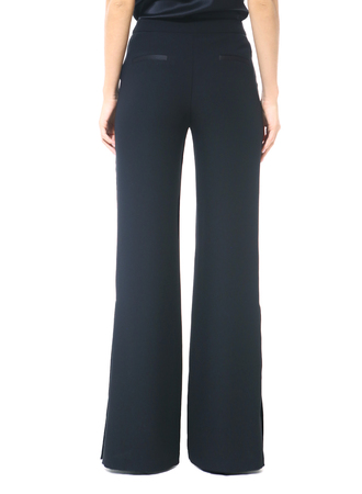 bell bottom formal trousers on model legs close up cut photo isolated on white Stock Photo