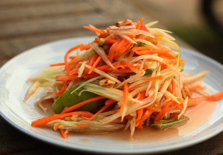 spicy papaya salad traditional thai dish served with fork