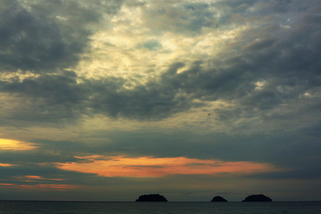 colorful pastes sunset on thai island with sea waves and hill on the horizon line Imagens - 96564810