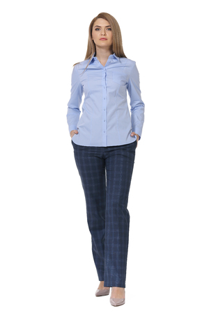 blond business woman executive posing in long sleeve blue blouse and jeans high heels stiletto shoes full body length isolated on white