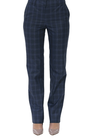 formal checked trousers with stripes on model legs with white stiletto heels Stock Photo
