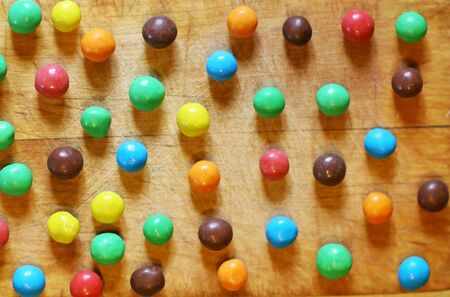 color candy round sweets on kitchen board close up photo Banco de Imagens