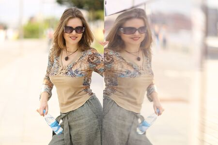 beautiful young woman in sun glasses send kiss street photo with mirror reflexion