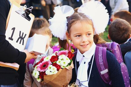 Moscow, Russia, September 1,2018: School pupil on the solemn meeting devoted to the beginning of shool year for first grade kids. Redactioneel