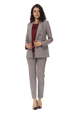 young caucasian business woman executive posing in woolen checked official power pant suit high heels stiletto shoes full body length isolated on white back view