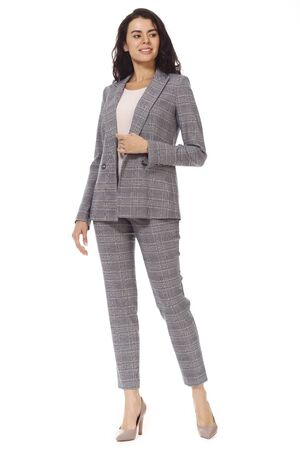 brunette business woman with long hair in formal official checkered pant suit high heels stiletto shoes full body photo isolated on white
