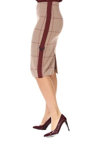 woolen formal checkered midi skirt with stripe cut close up photo on model legs in high heels isolated on white back view Stockfoto