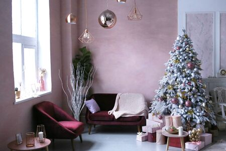 merry christmas card with christmas tree toys decoration presents close up photo on in pink room interior