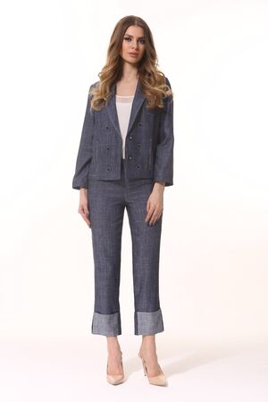 business woman executive posing in denim jeans suit jacket and trousers