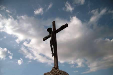 Statue of Jesus crucified on the top of a mount in Sardinia, Italy photo