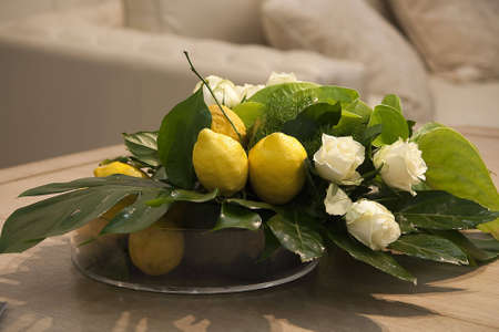 Composition Of A Few Lemons With Leaves And Roses photo