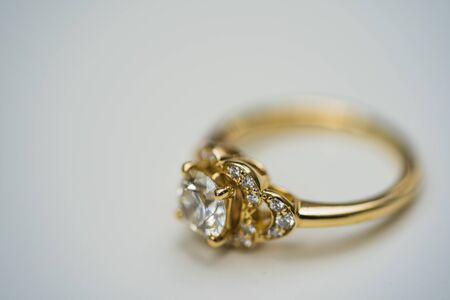 A close up of a beautiful gold diamond engagement ring