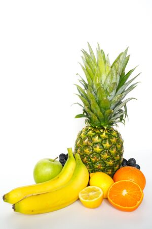 A selection of tropical fruit against a plain white background