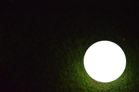 leading light: A Light Ball in a Garden Stock Photo