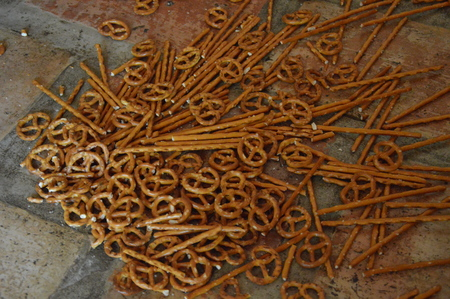collation: Pretzels and Sticks on the Floor Stock Photo