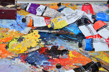 his: A painters palette In His Workshop Stock Photo