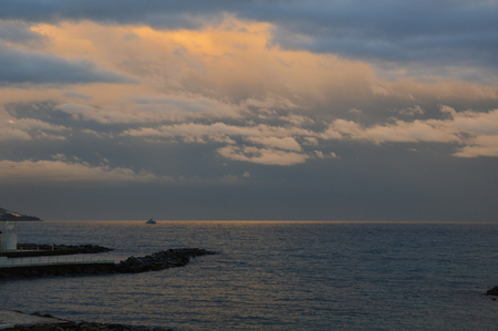 Sunset on the Mediterranean sea from the viewpoint of italy, with cloudy sky