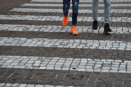 Zoom on a Crosswalk in a City (legs and shoes)