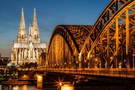 Hohenzollern Bridge and Cologne Cathedral at dusk, Koln, Germany Reklamní fotografie